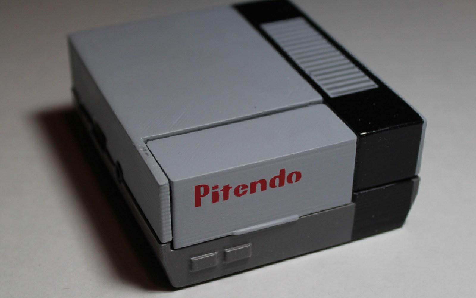 Relive your favorite classic video games with the pocket sized Pitendo NES emulator