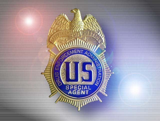 Two former soldiers were arrested for plotting to kill a an agent from the DEA.