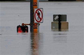 (AP Photo/Eric Gay). A flood gage shows waters just under 10 feet at an intersection, Saturday, May 25, 2013, in San Antonio.