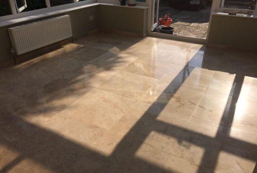Scratched travertine tiled floor after restoration in Hunt