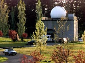 The planetarium show be in the square concrete building in Battle Point Park with the telescope dome