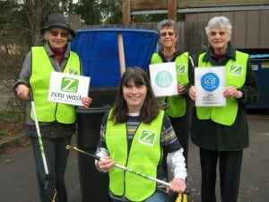 Diane Landry (kneeling) leads a Zero Waste team at an event -- (left to right) Gerlind Jenkner, Rosemary Courtright and Marci Burkel.