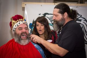 Ron Vener being shaved by Adam Theeke with the supervision of  Andrea Chandler, owner of Prim. Photo Credit: Shane Moore