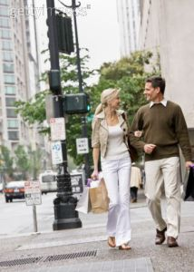 Man and woman walking down the street