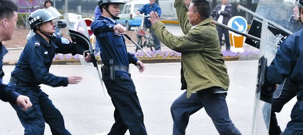 Police in China confront a knife-wielding attacker.