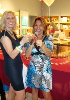 Model Virginia Loving winning a raffle prize from Shari Gherman at the Wine Carnival & Consumer Challenge sponsored by Patriot National Insurance Group. This gala event was held at Ft. Lauderdale's Museum of Art.