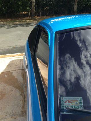 1977 Mazda RX-3 SP blue gutter