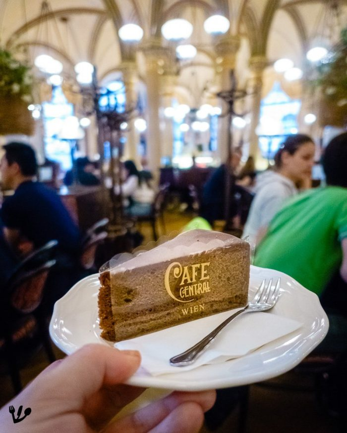 Sachertorte at Café Central where Hitler and Trotsky were patrons in 1913 Vienna, along with Lenin, Stalin, Tito, and Freud. The coffeehouse used to be a men's world, as opposed to the Konditorei, the pastry shop, where the women used to gather. As such the Sachertorte, intended as a masculine counterpart to fluffy and creamy tortes, is the coffeehouse's cake par excellence.