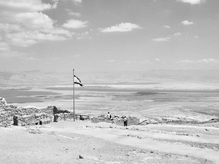 Flag of Israel in Masada with Dead Sea in the background