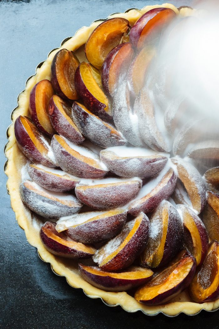 Cinnamon and superfine sugar on top of the Zwetschken kuchen (plum tart).