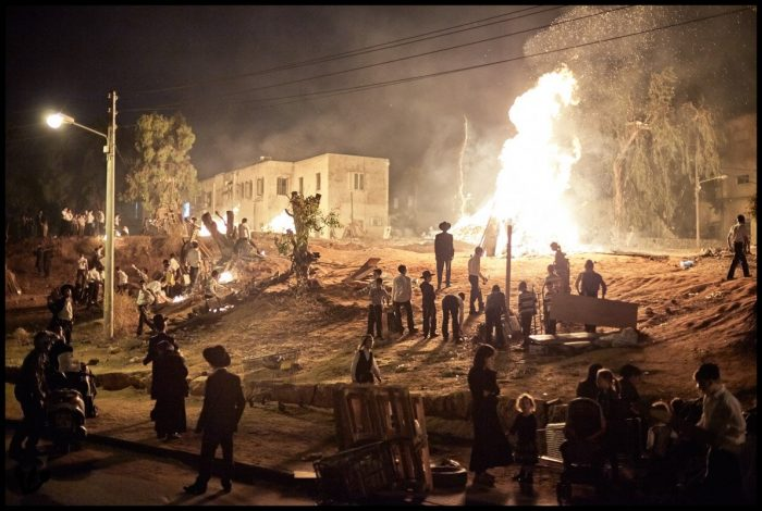 """Children gathering material for the bonfires for the Jewish holiday """"Lag BaOmer"""""""