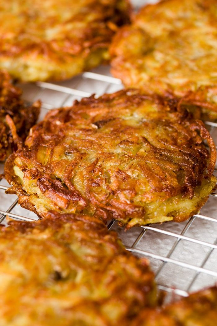 Use a rack or paper towels to drain the potato pancakes.
