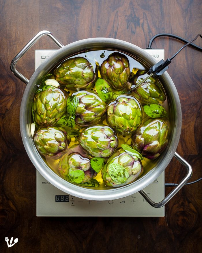 You can also confit larger artichokes or even cut them in half.
