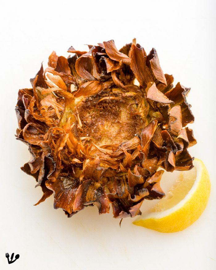"The glorious, Jewish-style artichoke,""carciofi alla giudia,"" looks like a big flower here. It is the pride and joy of Roman-Jewish cuisine."