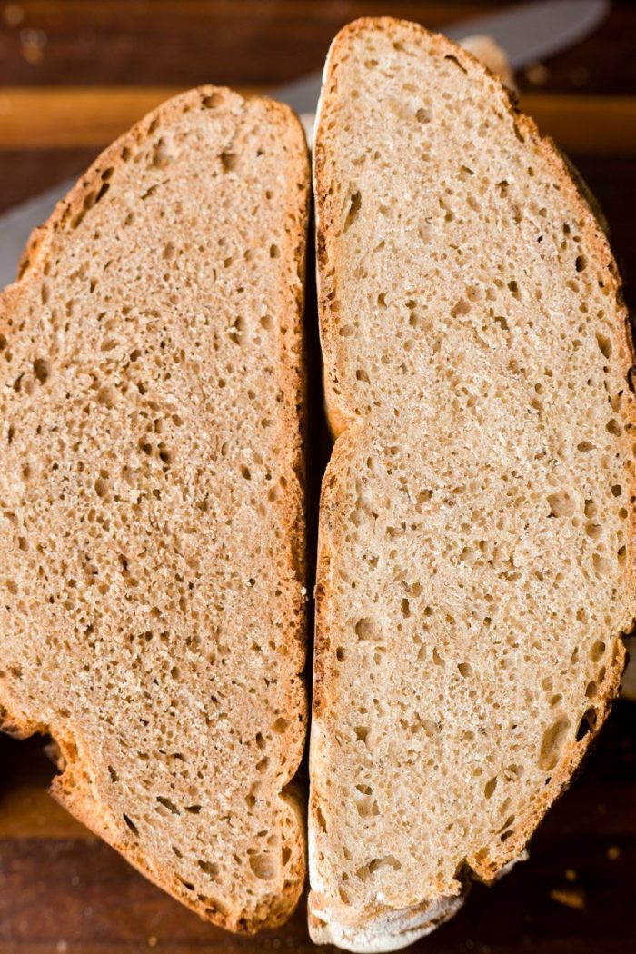 A whole-grain spelt no-knead loaf and a loaf made with half whole grain spelt and half white spelt.