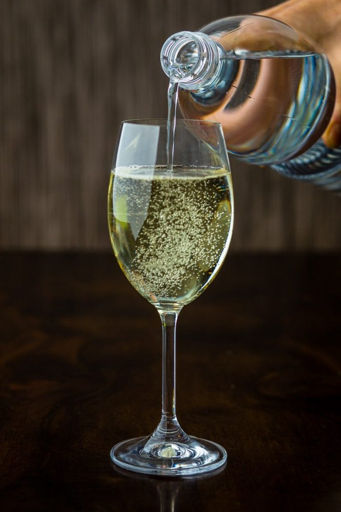 A glass of Spritzer. Dry white wine in Vienna, mostly Grüner Veltliner with sparkling mineral water or soda.