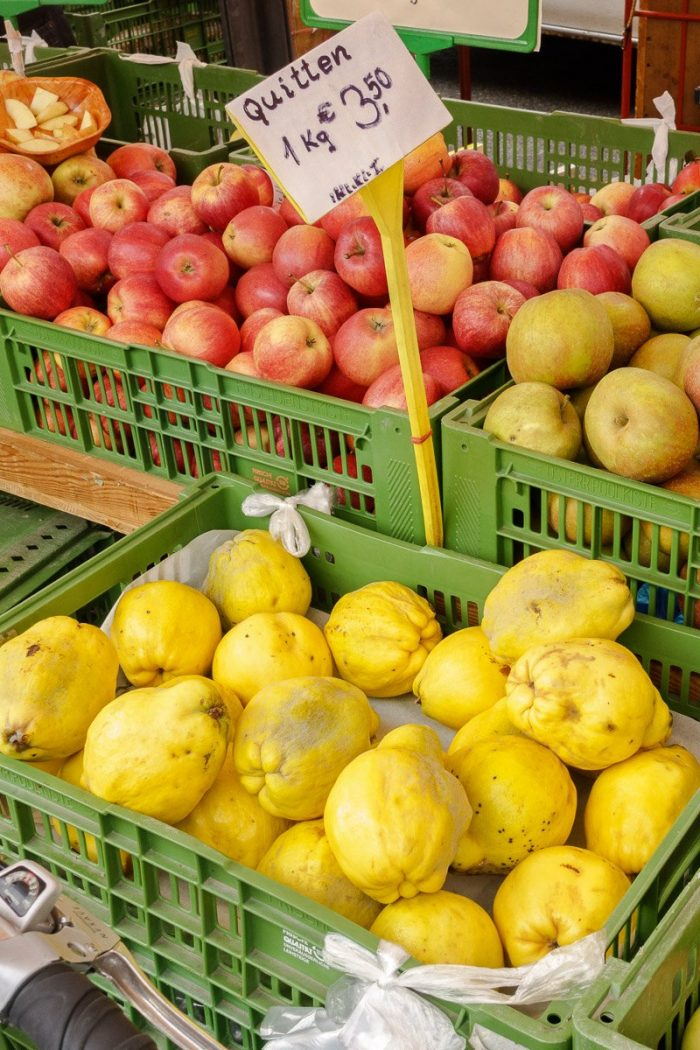 """Looking for organic quinces, """"Quitten,"""" at the """"Karmelitermarkt"""" farmer's market in Vienna's 2nd district for the poached quince recipe."""
