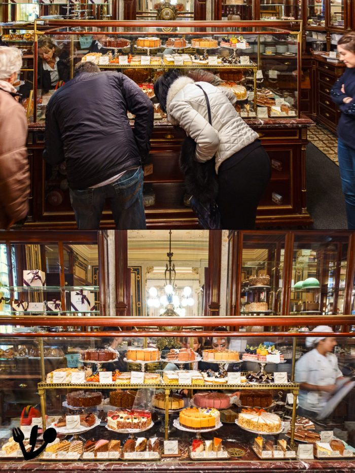 """The formidable vitrine is seldom free of people devouring the cakes with their eyes. Early in the morning, you can have a glimpse a the """"museum of Viennese tortes and pastries"""" main display. And if you are lucky, there's even a pastry chef in the picture!"""