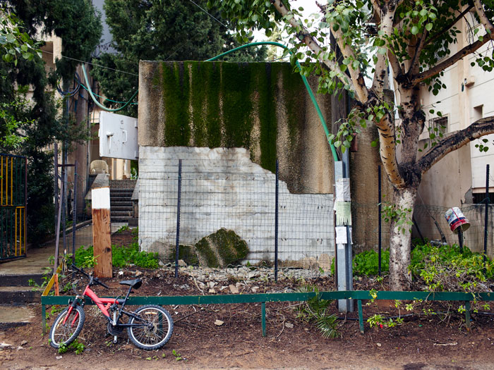 Bomb shelter with red bicycle in a Tel Aviv suburb