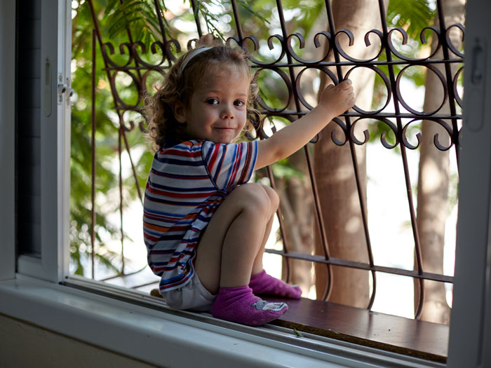 Child with iron window grill