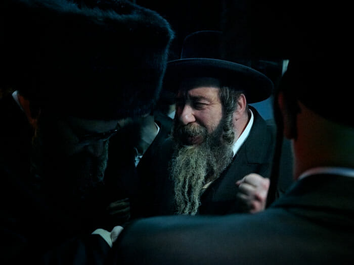 The Rachmastrivka Rebbe giving a bracha (blessing) to the father of the bridegroom