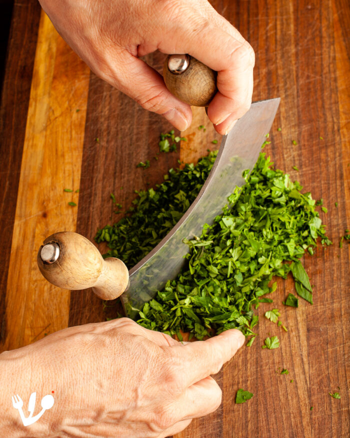 To chop up the fines herbes (chives, chervil, tarragon, and parsley) Michaela insisted on using our vintage mezzaluna knife.