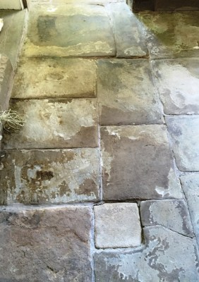 Flagstone floor before restoration in Chorley