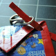 Step 15: Thread strap through case and hook snap or key ring