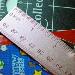 Step 9: Use straight edge to cut flap into triangle shape