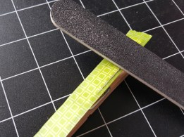 Step 2: Use nail file to file edges of tape and clothes pin