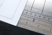 "Step 1: Measure paper to find center. Should be 5 1/2""."
