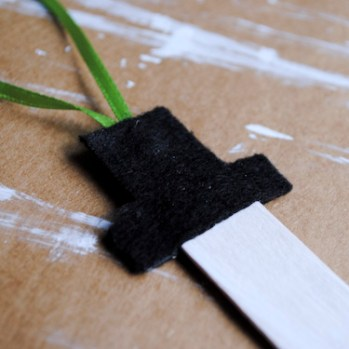 Step 5: Place second felt hat over the ribbon and tip of the craft stick.