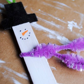 Step 7: Add fancy pipe cleaner scarf and twist or use glue dot to add the felt scarf.