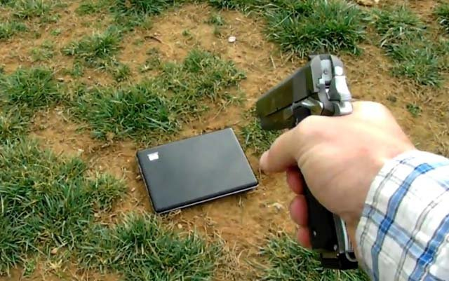 Tommy Jordan used a 45-caliber gun to shoot the laptop nine times. (Source: YouTube)