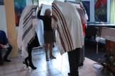 New Jews putting on their Talit