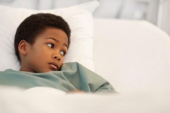 Black-child-layingin-hospital-bed