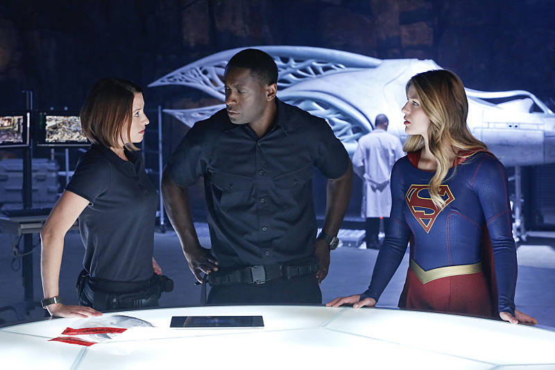 """How Does She Do It?"" -- Kara's two identities are stretched thin when Supergirl must protect National City from a series of bombings and Kara is tasked with babysitting Cat's son, Carter, on SUPERGIRL, Monday, Nov. 23 (8:00-9:00 PM, ET/PT) on the CBS Television Network. Pictured left to right: Chyler Leigh, David Harewood and Melissa Benoist Photo: Robert Voets/Warner Bros. Entertainment Inc. © 2015 WBEI. All rights reserved."