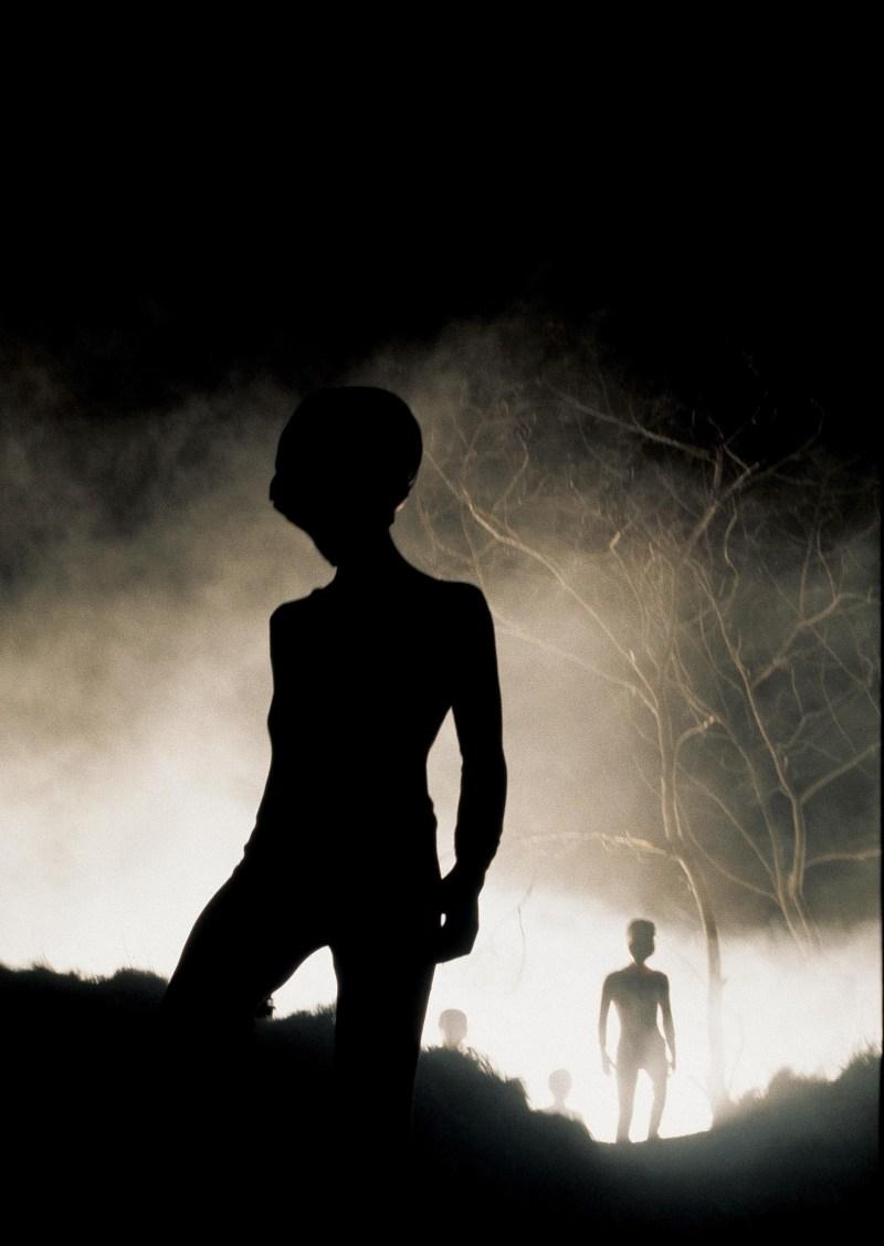 Dark alien-like figures