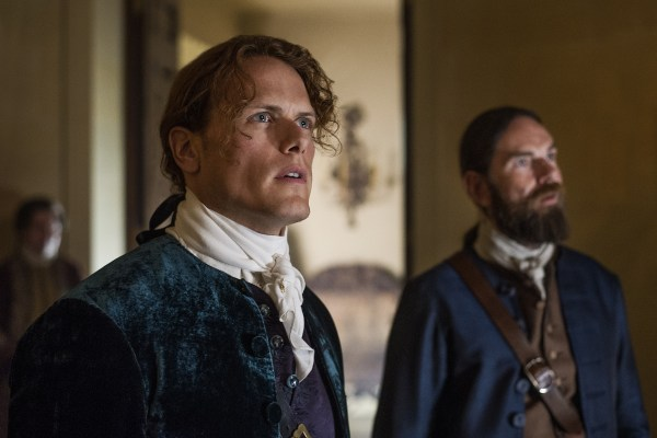 Jamie and Murtagh ogling Claire in her red dress.