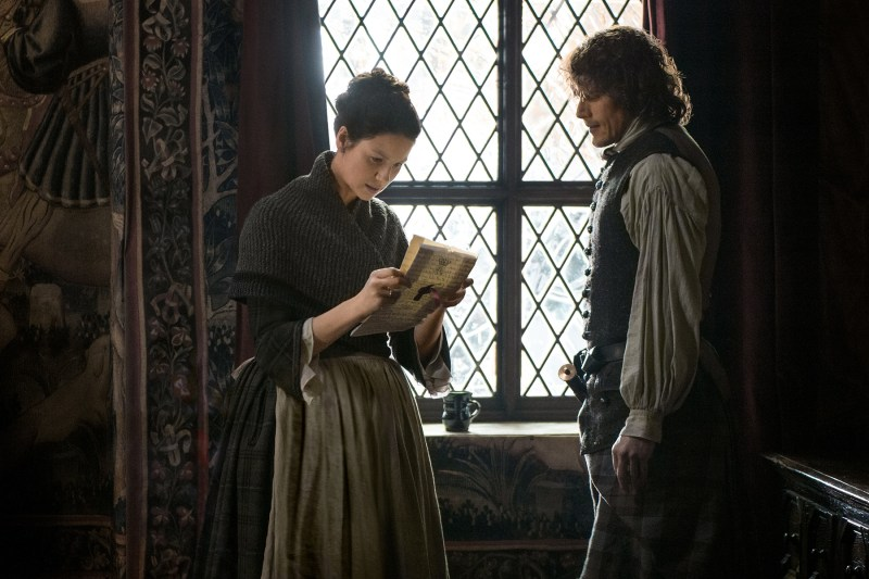 Jamie and Claire look over the letter that names Jamie a Jacobite supporter. Why can't this show just be about planting potatoes? I would be okay with that.