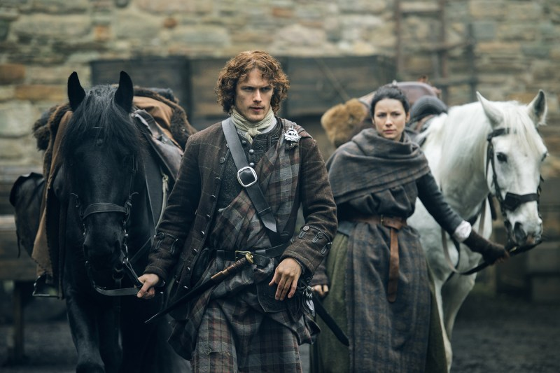 Jamie and Claire heading out of Lord Lovat's with their horses. Y'all with your witch-y business gonna get yourselves killed.