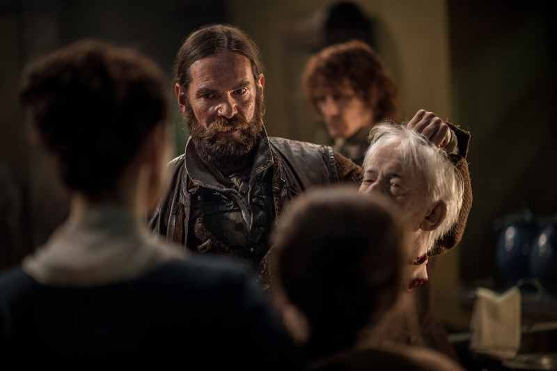 I mean, that is the man's head. Murtagh (Duncan Lacroix) is giving her the man's severed head. And it's awesome.