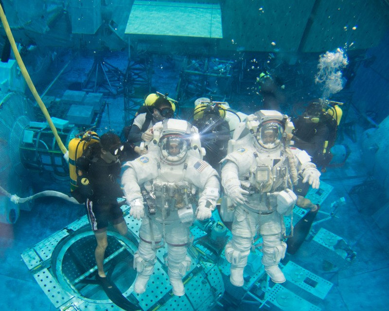 PHOTO DATE: 03-28-13 LOCATION: NBL - Pool Topside SUBJECT: Expedition 39 (Soyuz 37) crew members Rick Mastracchio and Koichi Wakata during pre-dive briefing, preparations and suitup, then lowering into the water. PHOTOGRAPHER: BILL STAFFORD
