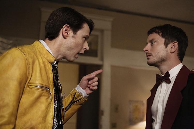 Dirk explains things to Todd (Elijah Wood).