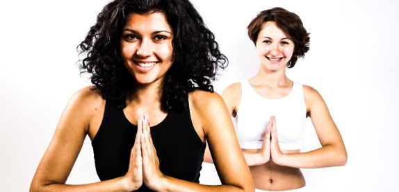 RelaxingMusic-yoga-zen-meditation-girls-women-practicing-smiling-group-exercise-white-background_edited
