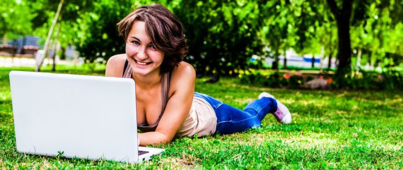 CollegeDegrees360-girl-laptop-grass-park-green-outside-nature-byod-road-warrior_edited