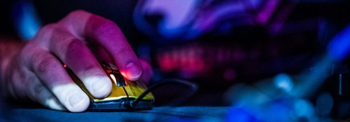 LAN Online Gaming eGames Competitive Player Championship Event SteelSeries Hand Mouse Closeup