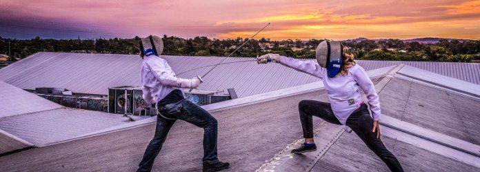 Fencing Top Of Rum Distellery Roof Fighting Sports Swords Rapier Suite Helmet Sunset