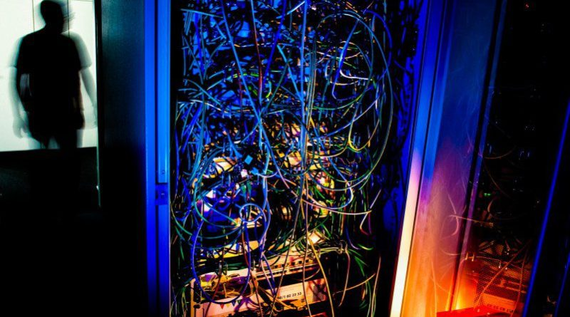 IT Server Lights Dark Engineer Data Center Operations Support Cables Chaos Hacker Data Theft Risk For Small Business Companies InfoSec CyberSec CyberCrime