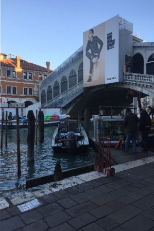 Realto Bridge in Venice, Italy remains under construction as the morning sun rises.